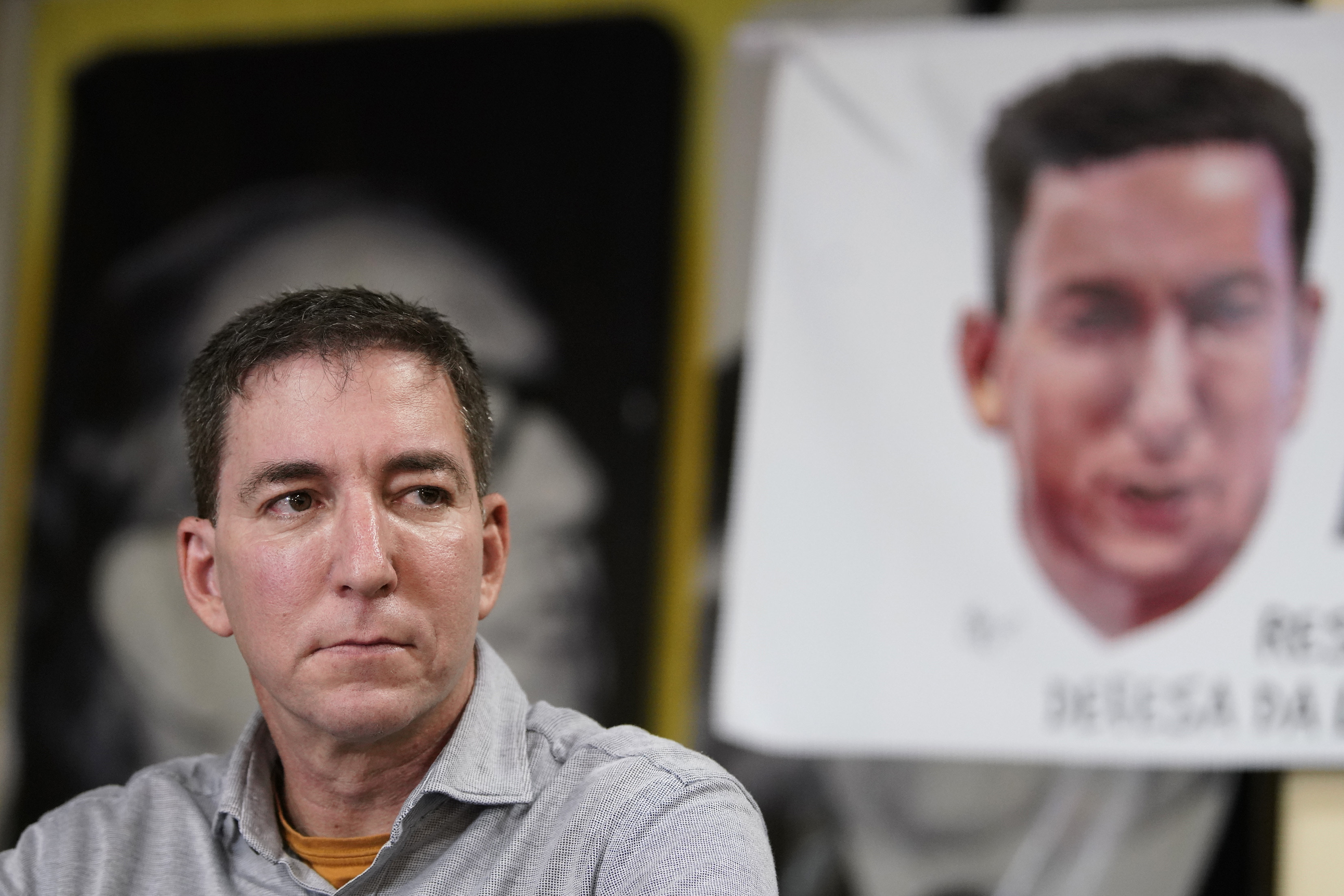 Award-winning journalist Glenn Greenwald listens to questions during a press conference before the start of a protest in his support in front of the headquarters of the Brazilian Press Association on July 30, 2019.