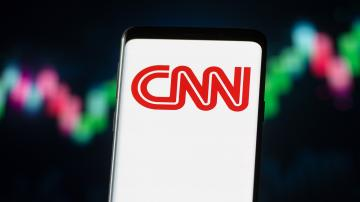 A picture of the CNN logo on a smart phone screen.
